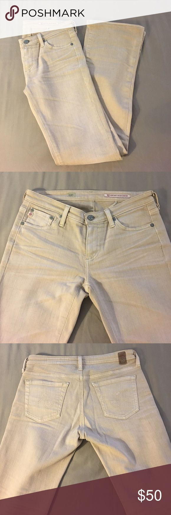 AG Jeans Adriano Goldschmied Women's Jeans size 27R, inseam 32 in. Style -  Angel Bootcut. Color is light tan. Never worn, great condition. AG Adriano Goldschmied Jeans Boot Cut