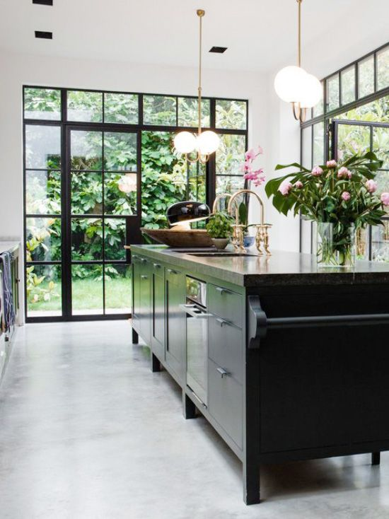 Modern black kitchen island with concrete floor and steel windows on Thou Swell @thouswellblog
