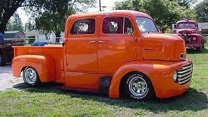 sweet 4 door orange C.O.E. Cab over Engine truck