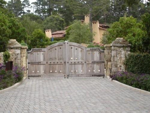A unique wooden driveway gate.