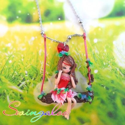 Swingaloos are lovely fairies on a swing, dangling on the chain of the necklace. These jewels are completely handmade, 100% Made in Italy.