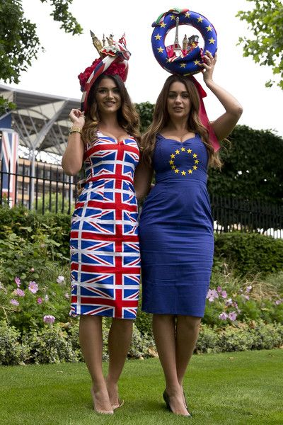 Models promoting betting for a bookmaker for the upcoming EU referendum pose for photographers on the first day on the first day of the Royal Ascot horse racing meet, in Ascot, west of London, on June 14, 2016.  / AFP / JUSTIN TALLIS