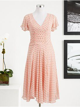 Isabel Flutter-Sleeve Dress from the Eva Mendes Collection at New York & Company for $90. What's nice about this dress is that the full skirt with ruching around the stomach area are slimming.