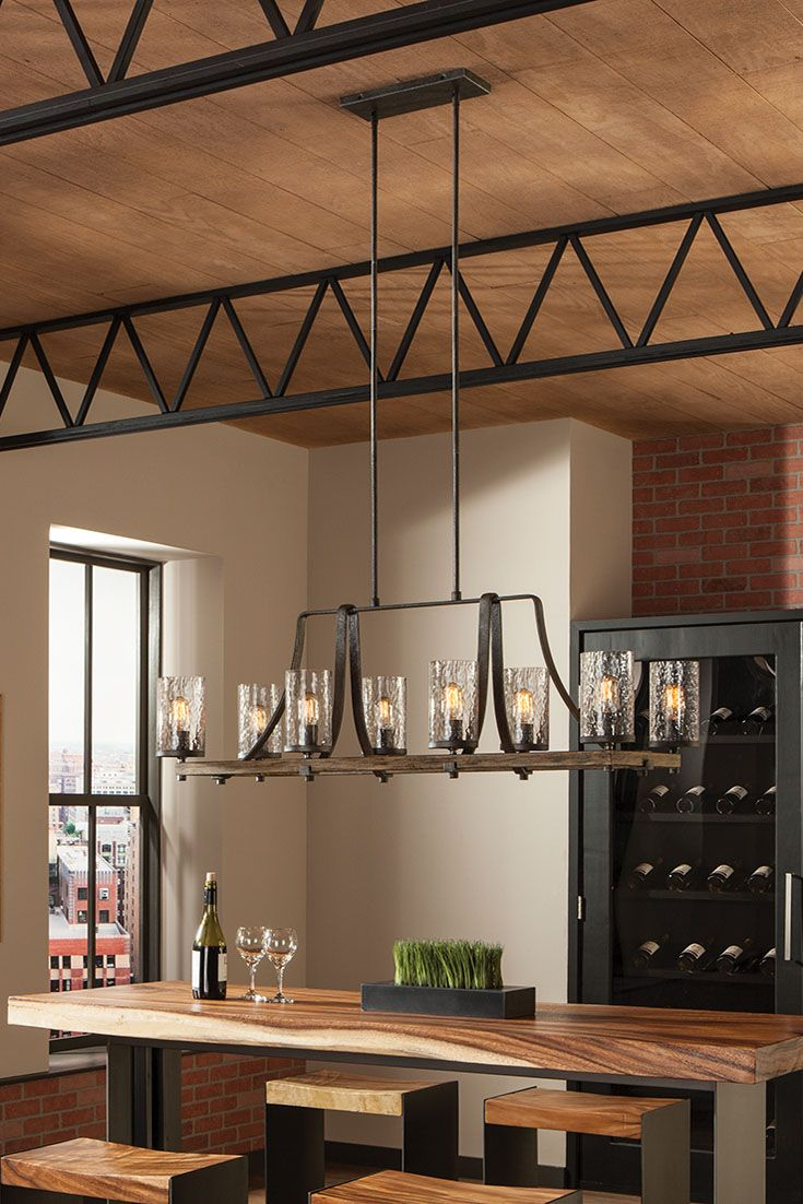Angelo 8 - Light Chandelier by Feiss: Celebrates the beauty of imperfection and the visual impact of mixed materials to create an overall rugged look. The cylindrical Clear Thick Wavy glass shades complement the two-toned finish of Distressed Weathered Oak on the outer structures and a new pitted, richly textured Slated Grey Metal finish on the sloping arms for a rustic but tailored look. Its design is perfect over a dining room table.