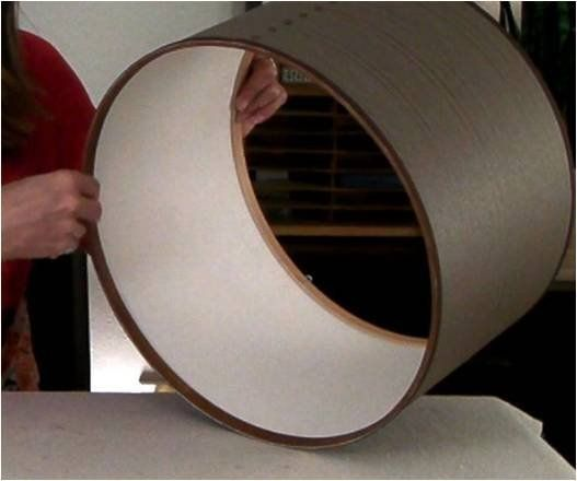 How to make a drum lamp shade.  For this DIY, Isabelle LaRue of Engineer Your Space explains how to make a custom shade to spiff up a less-than-exciting ceiling fixture.