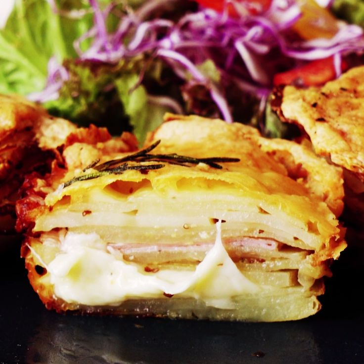 This isn't your average potato stack! Layered with cheese and prosciutto, these savory stacks make the perfect appetizers!