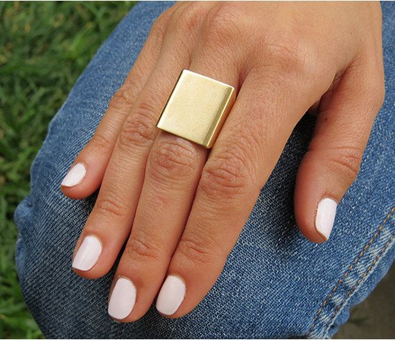 This Statement gold ring is Clean and smooth. A wide gold band adjustable ring that should fit most sizes! (6- 10) Ring measures: 15MM x 20MM  Made