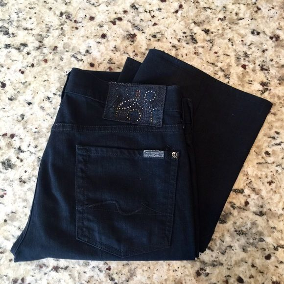 {7 For All mankind} Black Bootcut Jeans 7 For All Mankind classic bootcut jeans in black with unique detailing above back left pocket. There is a spot on the back of the waist where I say in some glue, the first time I wore them (see photo!). Ugh, so lame! Anyway, they're otherwise PERFECT so I'm pricing them accordingly. 7 for all Mankind Jeans Boot Cut