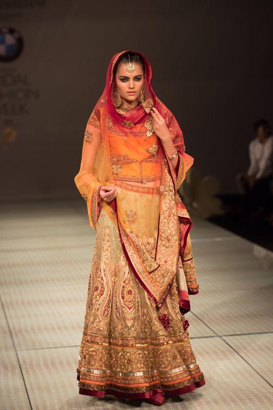 Tarun Tahiliani red orange gold bridal wedding lehnga. More here: http://www.indianweddingsite.com/bmw-india-bridal-fashion-week-ibfw-2014-tarun-tahiliani-show/