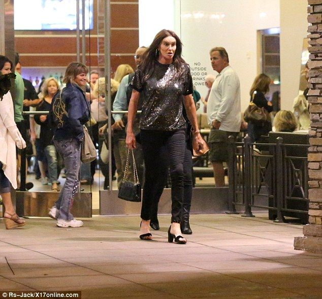 No longer part of the inner circle: Caitlyn Jenner goes to the cinema in Los Angeles on Saturday night while the rest of the Kardashian family support Khloe at Lamar's bedside in Nevada