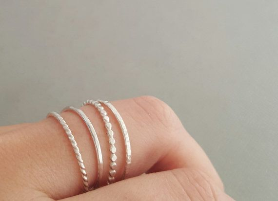 SET of 4 Thin Sterling Silver Stacking Rings Thumb Ring - Midi Ring - Pinky Ring  You will receive ~ FOUR dainty hand crafted stacking rings made from 925 sterling silver wire (as seen in the first photo)  ONE 16 gauge flat bead ring + ONE thin 16 gauge twist ring + ONE 16 gauge smooth ring + ONE 16 gauge textured ring  ♥ Available in US sizes from 3 - 10 ( including 1/2 and 1/4 sizes ) Select your size from the drop-down menu.  If you would like to order a different size for each ring…