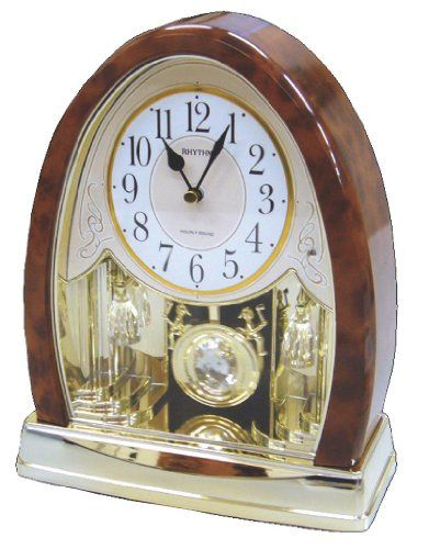 Joyful Crystal Bells Mantel Clock by Rhythm Clocks - 2010 Rhythm Clocks http://www.amazon.com/dp/B005U70N8M/ref=cm_sw_r_pi_dp_t8dAub0ZMDT74