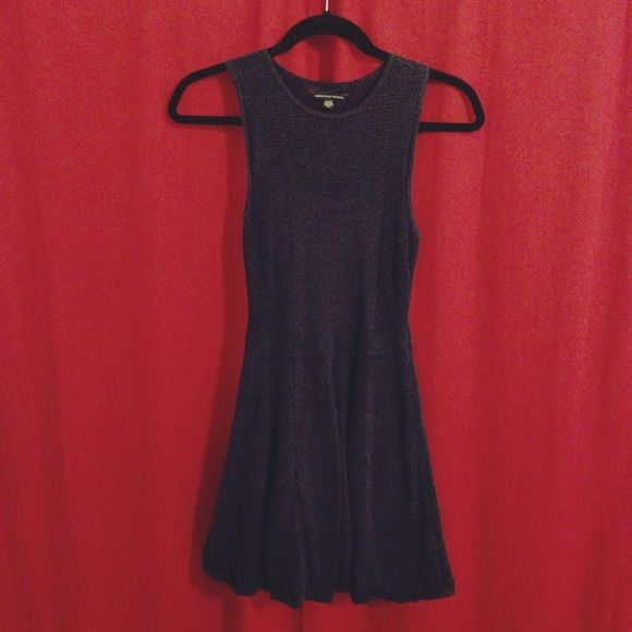 ✂️SALE: AEO Dark Blue Sweater Skater Dress A dark blue dress from American Eagle. A light sweater material with very pretty but subtle metallic accent woven in! Inside is lined, outer layer has a few mesh accents. Defined waist and skater skirt shape. Perfect for all seasons and stretchy enough to flatter any body type! XS but would fit an S just fine. Worn only 2-3 times. Please ask and make offers!  American Eagle Outfitters Dresses Midi