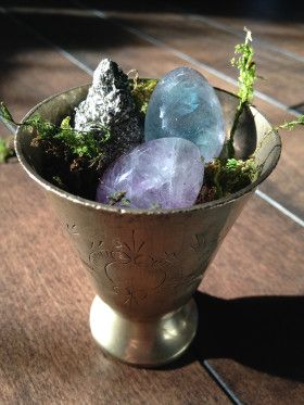 Ēostre Abundance Chalice: Only 2 made and 1 left! Two miniature fluorite eggs, and one piece of raw pyrite nestled in a vintage altar cup to fill your life with abundance in all manners.