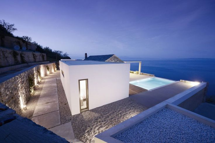 Studio 2 Pi Architect & 02 Architecture & Mech. Engineering Work Together to Design a Villa with Views Over the Sea in Pera Melana