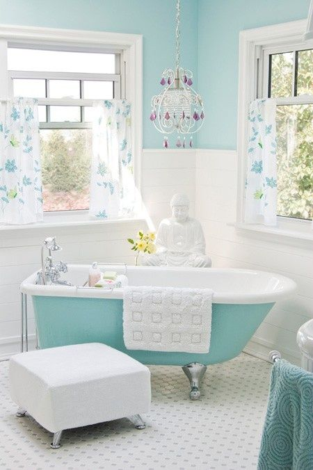 Aqua painted clawfoot tub , beach home cottage decor, complete with chandelier! Minus the Buddha!