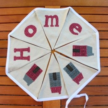 Linen Town House Home Motif Bunting --------------------------------------------- Beautiful 'Home' motif bunting with a town house appliqued design which would look great in any room in your home. The bunting is made from a lovely linen mix fabric and measures 2 metres in length with 8 flags.