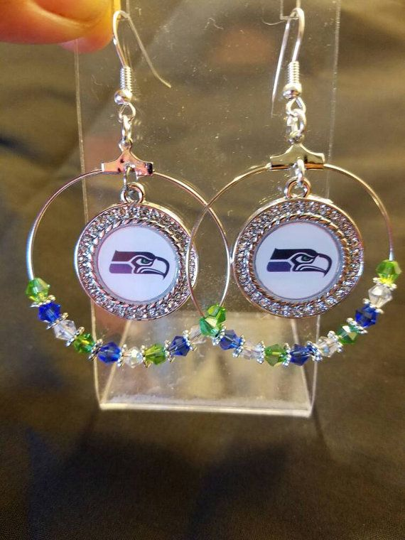 Check out this item in my Etsy shop https://www.etsy.com/listing/461971876/hoop-earrings-with-seattle-seahawks
