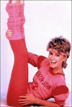 This image represents 1980's women's fashion because of the bright colors,patterns,and the leg warmers.Also the tights,headband,and hairstyle.