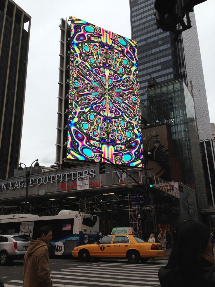 Broken electronic billboard being tested for all working colors on a grey day in NYC