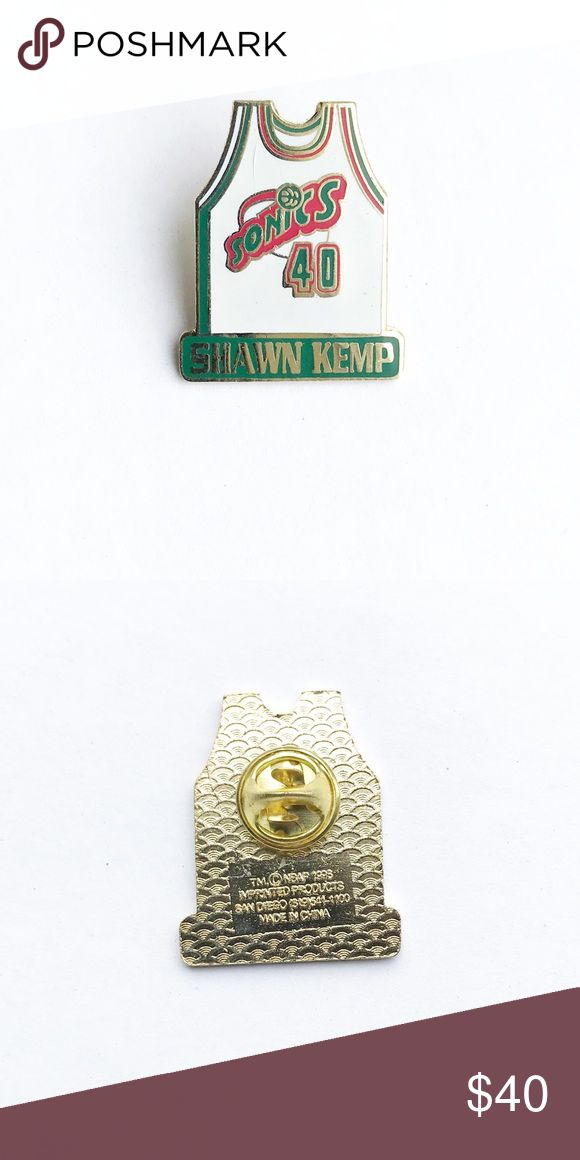 """'96 Shawn Kemp Jersey Enamel Pin 1996 Shawn Kemp Seattle Supersonics Jersey Enamel Pin  • true vintage  • 1  1/4"""" x 1"""" • includes original packaging & original licensed product sticker • colors: gold, white, red, green • tags: brooch, hat, lapel, jacket, bag, backpack, heart, team, lover, player, coach, basketball game, #40, NBA, national basketball league, MVP, hall of fame, Washington, RIP Sonics, collectible, memorabilia  • all of the pins I sell are vintage and may contain minor nicks…"""