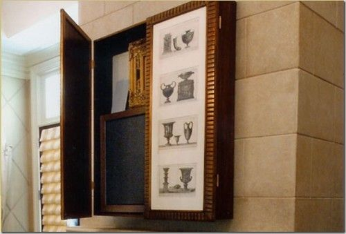 Nice way to disguise your flat screen... http://www.shelterness.com/how-to-fit-tv-into-any-interior-25-cool-ideas/