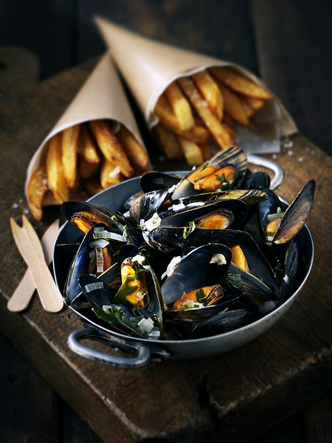 Moules Frites of Normandy! A visit to Normandy wouldn't be the same without some moules marinières, or moules frites. In the world famous mussels dish, the seafood is steamed in white wine and served with chips. #Foodphotography