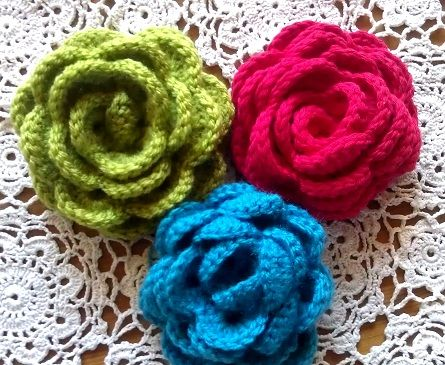 3 beautiful crochet flowers.  You'll have to translate the page from Dutch to English.
