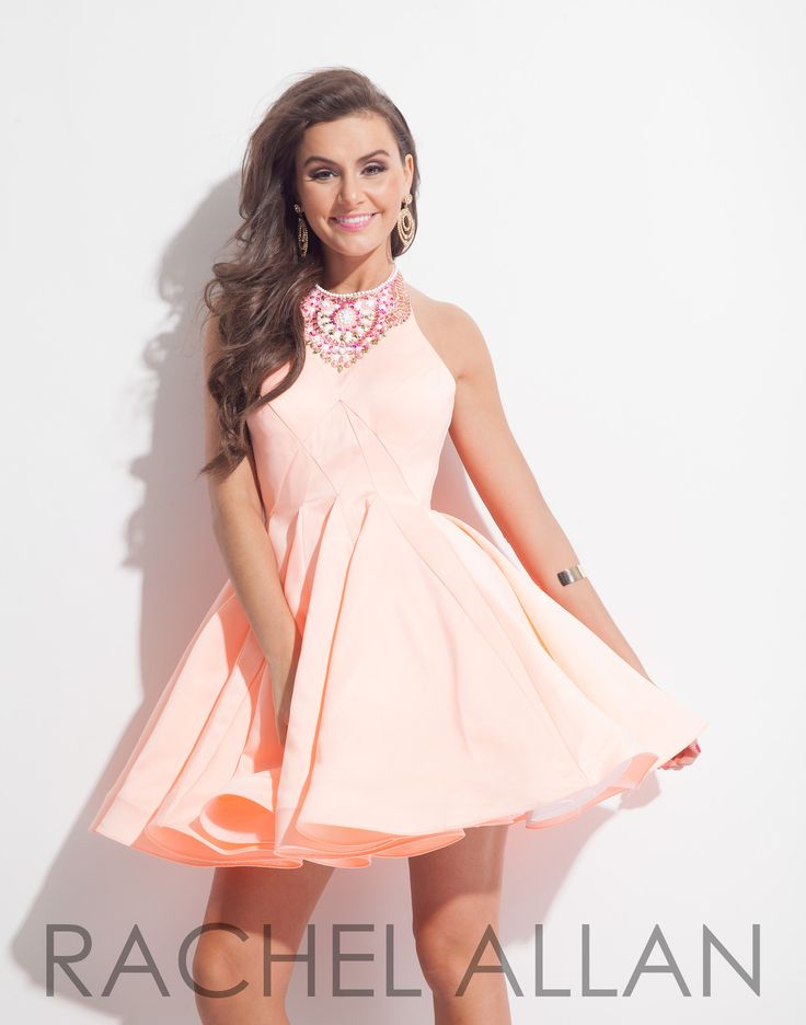 What a beautiful homecoming or sweet sixteen dress with its matte satin A-line skirt with seam manipulation and embellished neckline. Shown in Soft Coral and it's at Rsvp Prom and Pageant, Atlanta, GA
