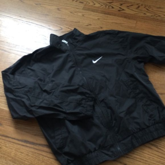 Black Nike windbreaker Men's size medium, this nike wind breaker is in excellent condition, has two front pockets and a back pocket. Nike Jackets & Coats