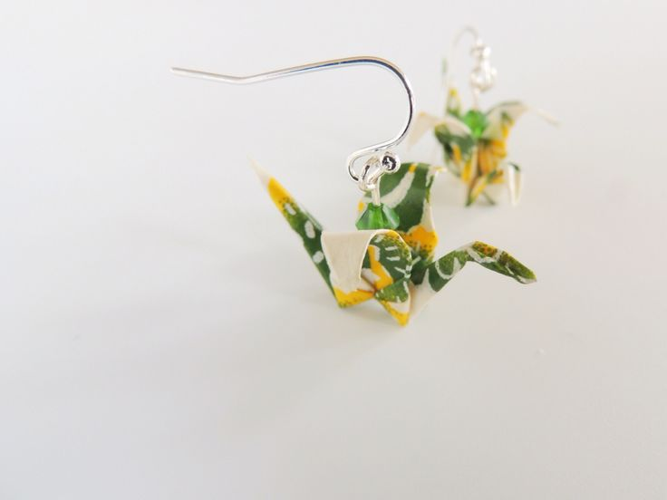 Small yellow and green crane earrings with curled wing tips and green crystals to accentuate. Handmade with love from Erigami Design!