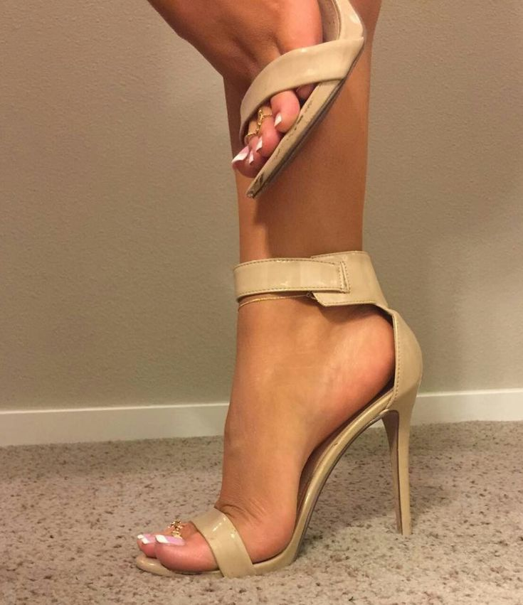 Gorgeous French toes and sexy strappy sandals.