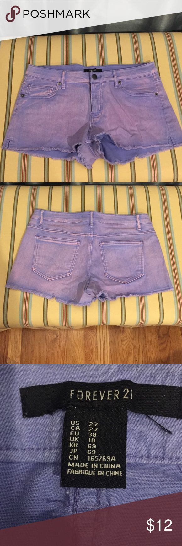 NWOT pink acid wash shorts Size 27, never worn. Fits mid torso. Spandex and jean material. Distressed bottoms made by manufacturer. no trades Forever 21 Shorts Jean Shorts