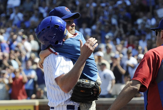 CHICAGO, IL - MAY 18: Kerry Wood #34 of the Chicago Cubs hugs his son Justin after pitching against the Chicago White Sox  on May 18 2012 at Wrigley Field in Chicago, Illinois. Kerry Wood faced one batter that he  struck out in the eighth inning. inning. It was announced that Kerry Wood is retiring from baseball today.  (Photo by David Banks/Getty Images): Kerry Wood, Wood Faces, Wood 34, Baseball Photos, Baseb Photo