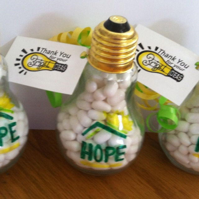 "Thank you for your ""Bright Ideas"" corporate favor. Light bulb jar found at Hobby Lobby, paint on a quick logo fill with tic tacs and add a little tag and your done."