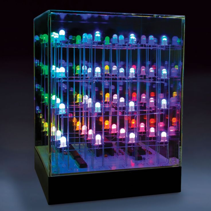 Hammacher Schlemmer | The Illumicube - This clear acrylic cube is filled with 64 multi-colored LEDs that systematically illuminate in millions of different combinations, producing a mesmerizing light show.
