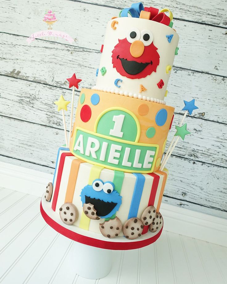 Sesame Street first birthday cake all buttercream with fondant decor. Elmo and Cookie Monster first birthday cake