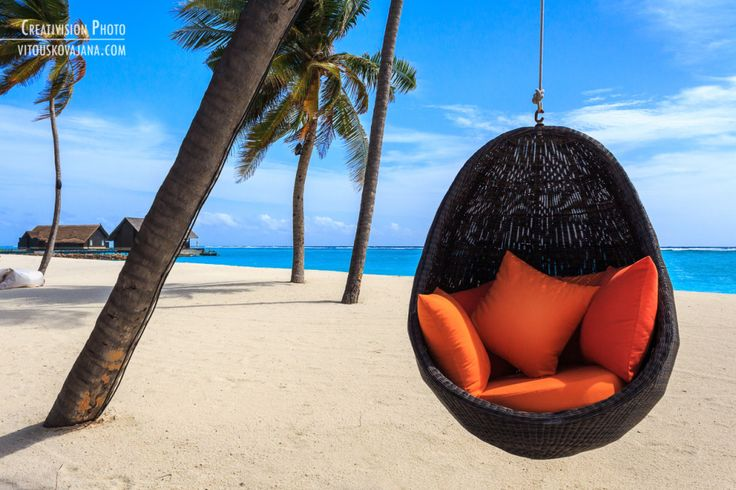 Relax at the beach at One & Only Reethi Rah resort in Maldives