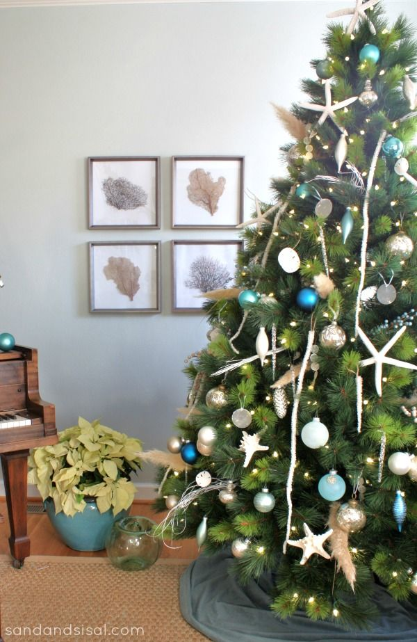 Kim of @Sand and Sisal celebrates her love for the sea with her coastal Christmas tree! #ChristmasInJuly: Coastal Christmas Trees, Beachy Christmas Trees, Christmas Trees Coastal, Christmas Trees Beach Theme, Beach Christmas Trees, Christmas Theme, Coastal Decor, Coastal Holiday