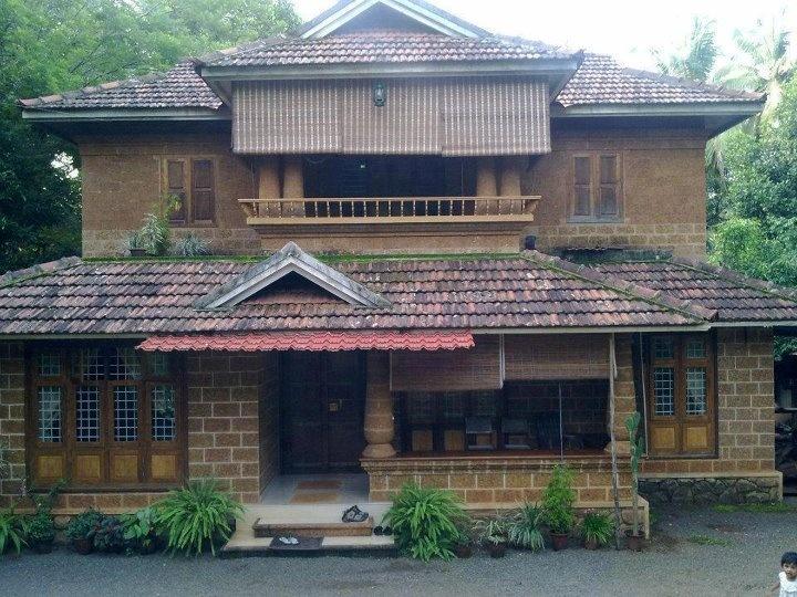 A typical kerala style house... using Vettukallu (a type of brick)
