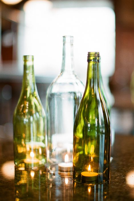 Great upcycled glass bottle centerpiece glass bottle art for Glass bottle centerpiece ideas