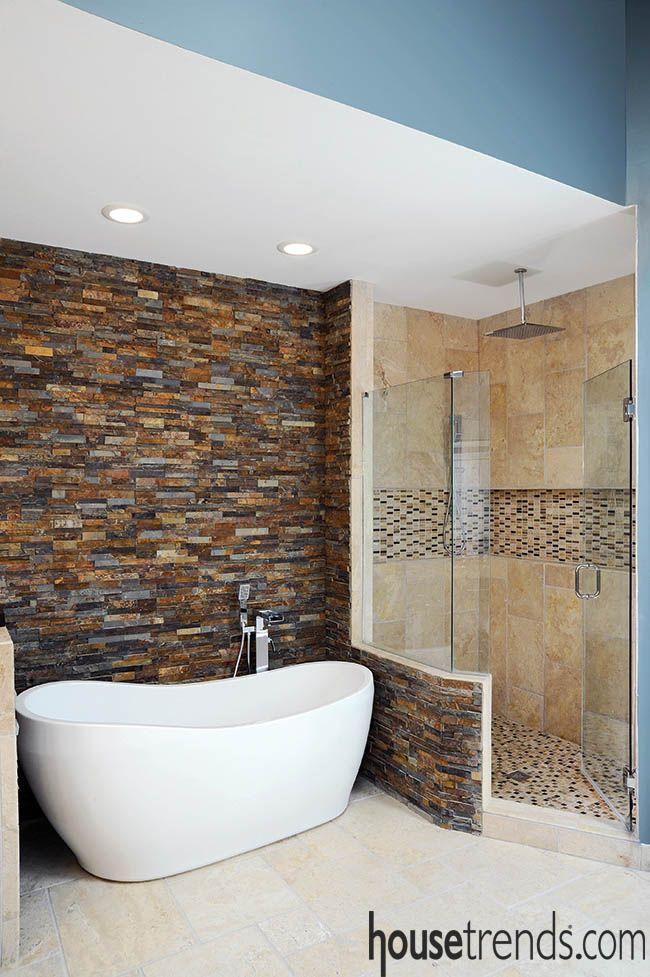 Accent wall spotlights a soaking tub