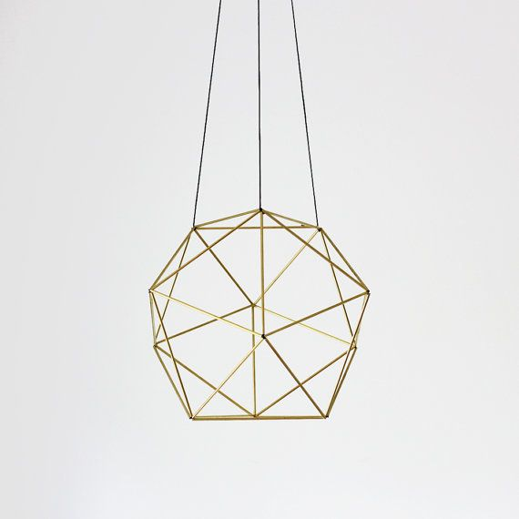 A modern take inspired by a Finnish tradition - this geometric hanging mobile is called a Himmeli, from the Swedish word 'himmel' meaning sky or heaven. They were created to celebrate the beginning of Winter Solstice and serve a means of good fortune for the future.