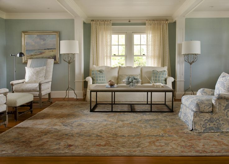 Loving the rug and the overall alignment in this room. The palate is subdue making it very calm. Not sure about the armchair on the right though or the hanging picture.