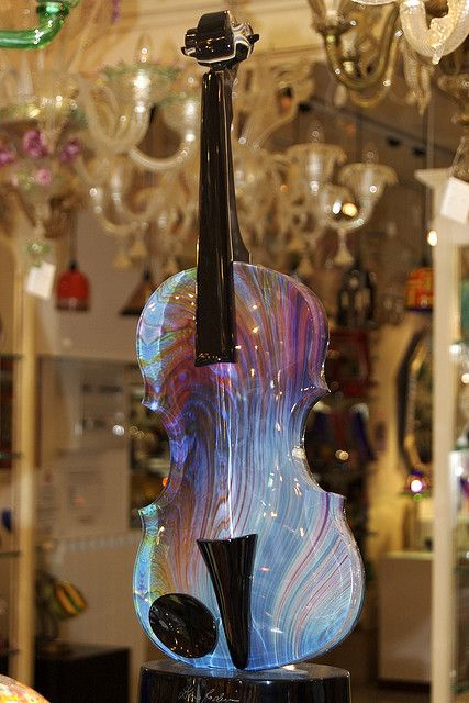 This particular instrument appears to be made of glass.  When I played my viola, the instrument and the music emanating from it seemed to take on a life of its own.