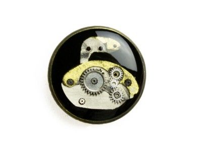 Sport-Curling pin made of the mechanisms of the watch flooded resin.