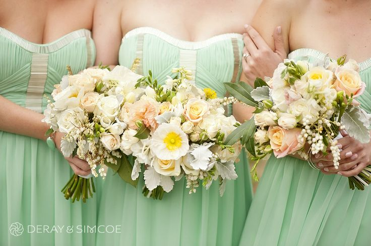 Mixed bride and bridesmaids bouquets with hints of yellow and grey against mint green dresses.  Photography by DeRay & Simcoe Bouquets by Zinnia Floral designs