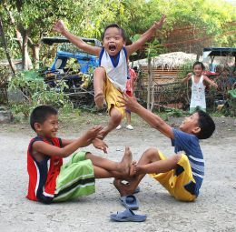 "The ""luksong tinik"" a traditional street jumping game. I used to play this game."