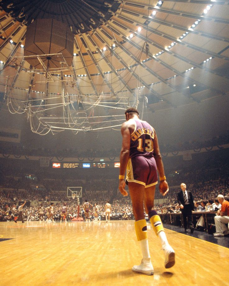 LA Lakers center Wilt Chamberlain walks back to the action on the court against the New York Knicks during a game at Madison Square Garden circa 1970's in New York, New York