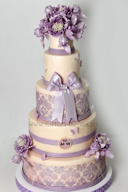 Ivory & Purple Cake  www.tablescapesbydesign.com https://www.facebook.com/pages/Tablescapes-By-Design/129811416695